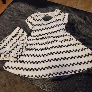 Polka dot dress with romper bottom.